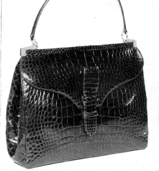 Elegant Alligator In A Ious Semi Pouch Tailored Bag Has Tab Closing Ond Detailed Frame Interest Shown At Theodore Rendle 165 Madison Ave